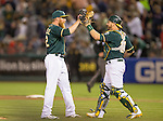 Sean Doolitle and Stephen Vogt celebrate the win.<br />