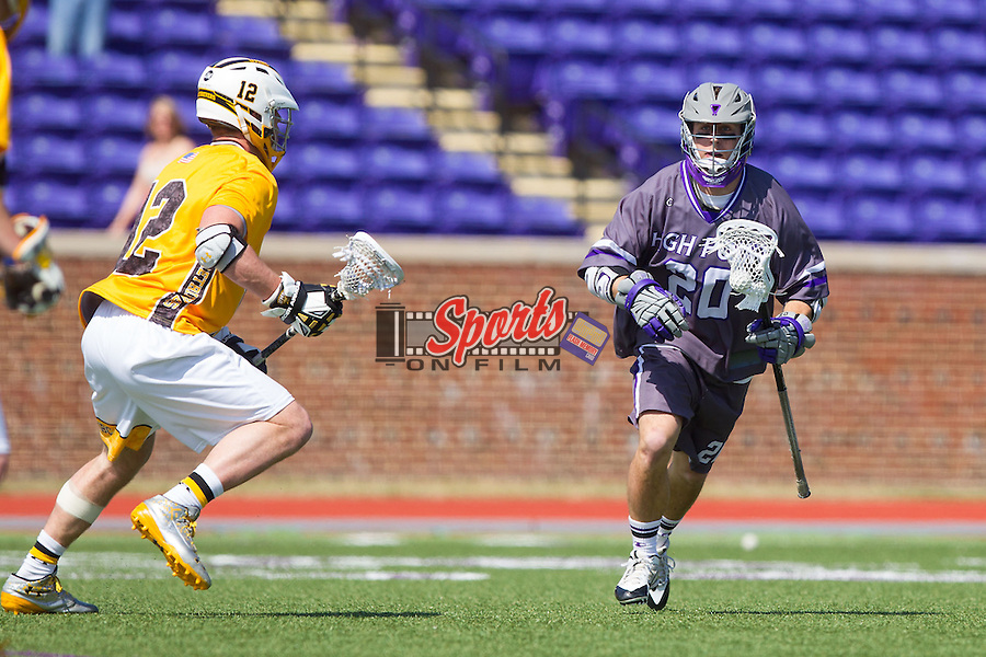 Brendan Montrello (20) of the High Point Panthers keeps the ball away from Kevin McDonough (12) of the UMBC Retrievers at Vert Track, Soccer & Lacrosse Stadium on March 15, 2014 in High Point, North Carolina.  The Panthers defeated the Retrievers 17-15.   (Brian Westerholt/Sports On Film)