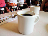Cup of coffee in a diner.