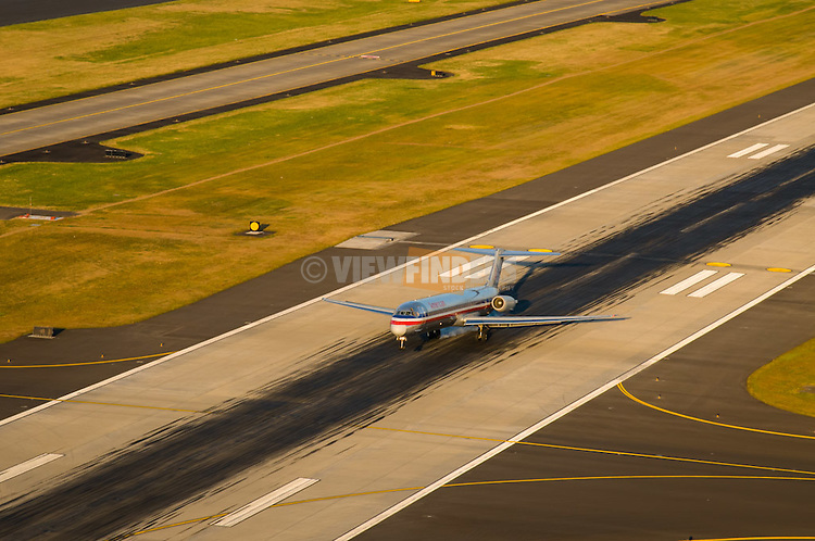 Aerial view of a commercial airplane landing at the Portland International Airport in Portland, Oregon.