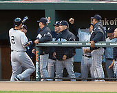 New York Yankees shortstop Derek Jeter (2) is congratulated by his teammates after his first inning lead-off home run against the Baltimore Orioles at Oriole Park at Camden Yards in Baltimore, MD on Tuesday, April 10, 2012..Credit: Ron Sachs / CNP.(RESTRICTION: NO New York or New Jersey Newspapers or newspapers within a 75 mile radius of New York City)