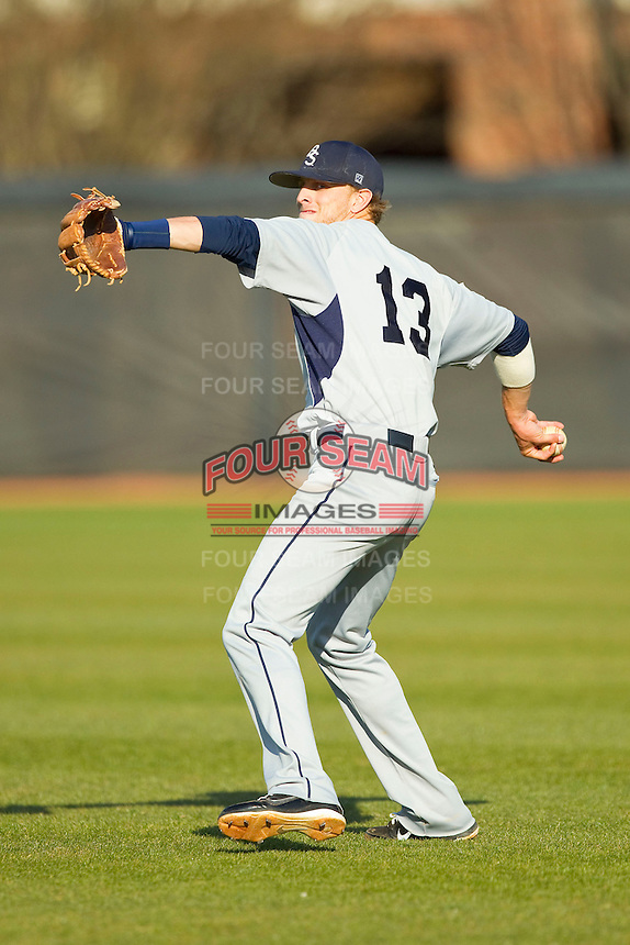 Brent Pugh (13) of the Georgia Southern Eagles warms up in the outfield prior to the game against the UNCG Spartans at UNCG Baseball Stadium on March 29, 2013 in Greensboro, North Carolina.  The Spartans defeated the Eagles 5-4.  (Brian Westerholt/Four Seam Images)
