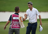 Ross Fisher (ENG) shakes hands with with caddie Thomas Soby (Morten Orum Madsen (DEN)) as they complete Round Three of The Tshwane Open 2014 at the Els (Copperleaf) Golf Club, City of Tshwane, Pretoria, South Africa. Picture:  David Lloyd / www.golffile.ie
