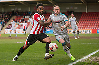 Jordan Cranston of Cheltenham Town shields the ball from Ben Davies of Grimsby during the Sky Bet League 2 match between Cheltenham Town and Grimsby Town at the The LCI Rail Stadium,  Cheltenham, England on 17 April 2017. Photo by PRiME Media Images / Mark Hawkins.