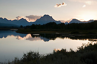 Mt. Moran reflects in the still waters of Oxbow Bend in the evening