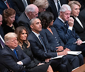 United States President Donald J. Trump, first lady Melania Trump, former US President Barack Obama, former first lady Michelle Obama, former US President Bill Clinton, and former US Secretary of State Hillary Rodham Clinton react during the eulogies to the the late former US President George H.W. Bush at the National funeral service in his honor at the Washington National Cathedral in Washington, DC on Wednesday, December 5, 2018.<br /> Credit: Ron Sachs / CNP<br /> (RESTRICTION: NO New York or New Jersey Newspapers or newspapers within a 75 mile radius of New York City)