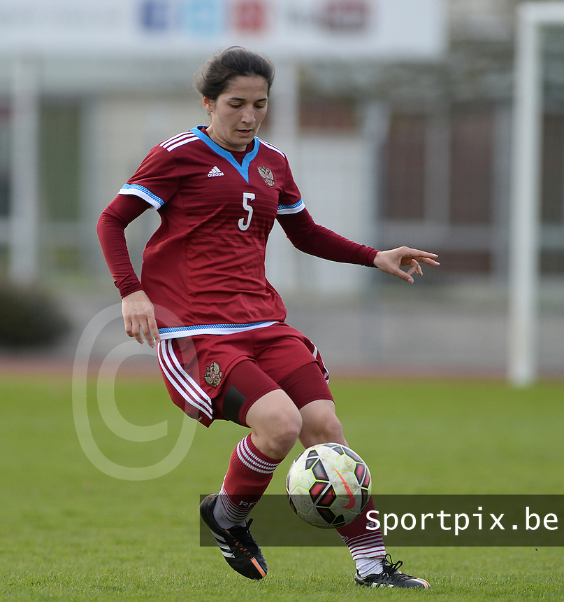 20150406 - MELUN , FRANCE  : Russian Ksenia Dzhinikashvili (5) pictured in action during the soccer match between Women Under 19 teams of Iceland and Russia , on the second matchday in group 3 of the UEFA Elite Round Women Under 19 at Stade Municipal , Melun , France . Monday 6th April 2015 . PHOTO DAVID CATRY