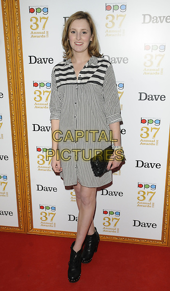LAURA CARMICHAEL .The Broadcasting Press Guild TV & Radio Awards, Theatre Royal, Drury Lane, London, England..March 25th, 2011.full length grey black stripe white dress ankle boots clutch bag sihrt.CAP/CAN.©Can Nguyen/Capital Pictures.
