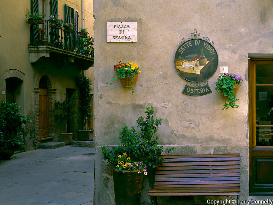 Tuscany, Italy: Street scene with an osteria's bench on the Piazza di Spagna - Pienza