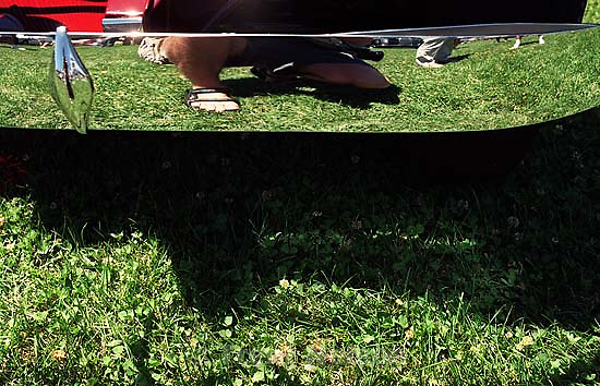 Trent feet in reflection at concours car show<br />