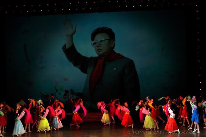 Children bow in worship of an image of North Korean dictator Kim Jong-Il during a performance in Pyongyang, North Korea (DPRK) on 16 August, 2007.