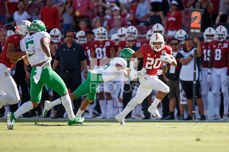 STANFORD, CA - SEPTEMBER 21: Austin Jones #20 of the Stanford Cardinal rushes for 11 yards in the first quarter before being tackled by Nick Pickett #16 of the Oregon Ducks during a game between University of Oregon and Stanford Football at Stanford Stadium on September 21, 2019 in Stanford, California.