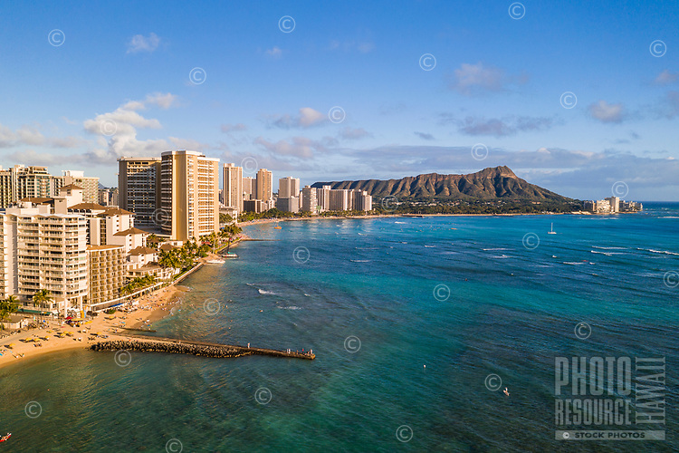 Aerial afternoon view of O'ahu's Waikiki, Diamond Head and the Gold Coast, Honolulu, O'ahu.