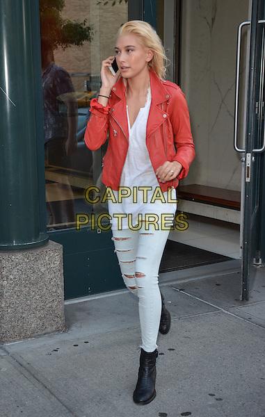 NEW YORK, NY - SEPTEMBER 1: Hailey Baldwin talks on the phone in New York, New York on September 1, 2014. <br /> CAP/MPI/RW<br /> &copy;RW/MPI/Capital Pictures