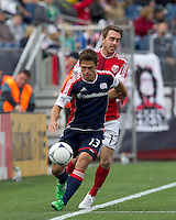 New England Revolution midfielder Ryan Guy (13) controls the ball as Portland Timbers midfielder Eric Alexander (17) pressures. In a Major League Soccer (MLS) match, the New England Revolution defeated Portland Timbers, 1-0, at Gillette Stadium on March 24, 2012