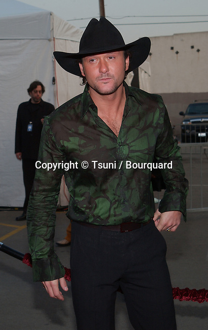 Tim McGraw arrives at the 29th Annual American Music Awards at the Shrine Auditorium in Los Angeles Wednesday, Jan. 9, 2002. P          -            McGrawTim02.jpg