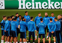 Real Madrid's coach Zinedine Zidane, right, talks to his players before to start a practice session ahead of the Champions League round of 16 first leg football match against Roma, at Rome's Olympic stadium, 16 February 2016.<br /> UPDATE IMAGES PRESS/Riccardo De Luca