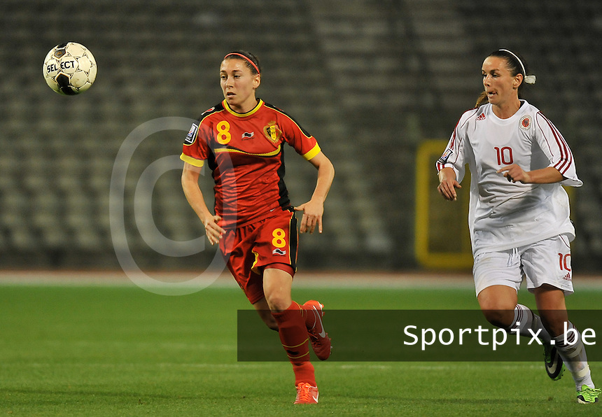 20130921 - BRUSSELS , BELGIUM : Belgian Audrey Demoustier (8) pictured with Albanian Velaj Furtuna (10) during the female soccer match between Belgium and Albania , on the first matchday in group 5 of the UEFA qualifying round to the FIFA Women World Cup in Canada 2015 at the Koning Boudewijn Stadion , Brussels . Saturday 21th September 2013. PHOTO DAVID CATRY
