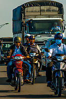 Motorcycles crossing over the Cau Cai Rang Bridge in the Mekong Delta, Vietnam.