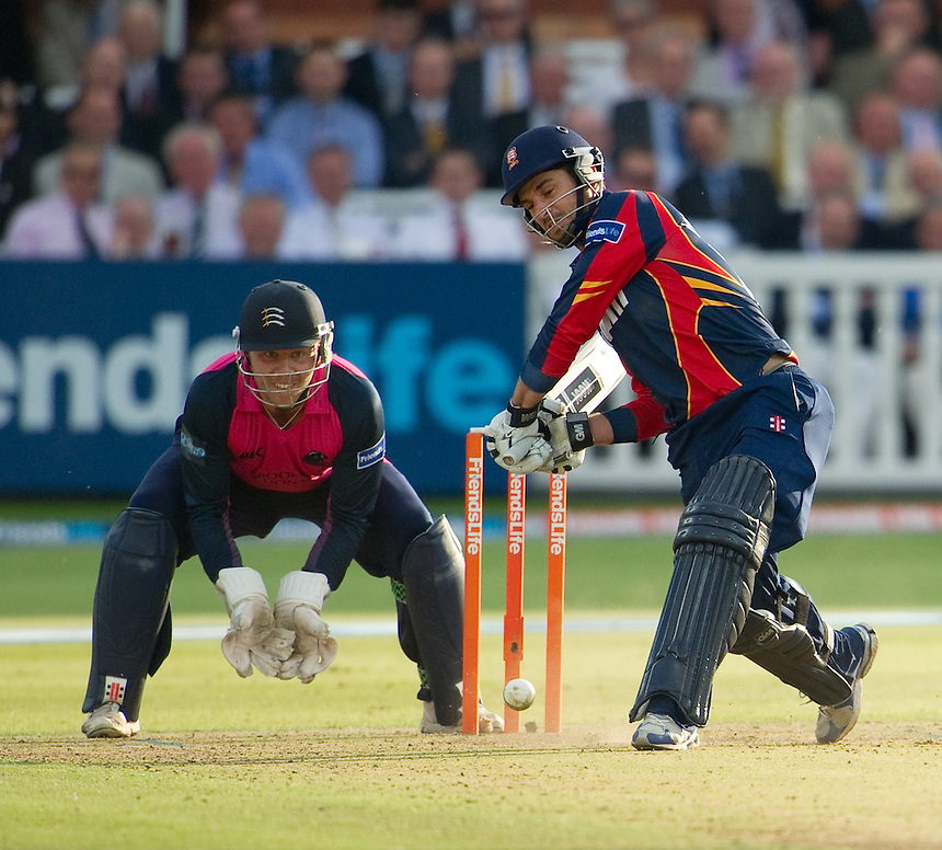 Essex Eagles' Ryan ten Doeschate drives off the bowling of Middlesex's Adam Voges whilst wicket-keeper Adam Rossington looks on<br /> <br />  (Photo by Ashley Western/CameraSport) <br /> County Cricket - Friends Life t20 2013 - Middlesex v Essex - Thursday 04th July 2013 - Lord's, London <br /> <br />  &copy; CameraSport - 43 Linden Ave. Countesthorpe. Leicester. England. LE8 5PG - Tel: +44 (0) 116 277 4147 - admin@camerasport.com - www.camerasport.com