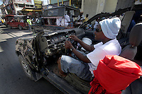 A man drives what remains of his car, 2 weeks after an earthquake in Port au Prince, Haiti, Jan. 26, 2010. (Australfoto/Douglas Engle)