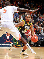 CHARLOTTESVILLE, VA- DECEMBER 6: Corey Edwards #13 of the George Mason Patriots drives the ball past Assane Sene #5 of the Virginia Cavaliers during the game on December 6, 2011 at the John Paul Jones Arena in Charlottesville, Virginia. Virginia defeated George Mason 68-48. (Photo by Andrew Shurtleff/Getty Images) *** Local Caption *** Assane Sene;Corey Edwards