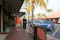 Couple browsing shops on Corey Avenue.  St. Pete Beach Tampa Bay Area Florida USA