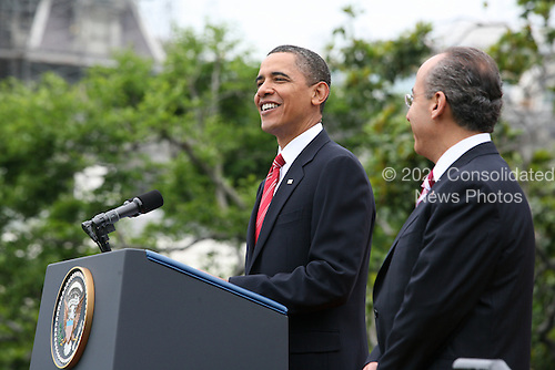 United States President Barack Obama and the First Lady Michelle Obama welcome President Felipe Calderón of Mexico and his wife Margarita Zavala to the White House.  The official arrival ceremony took place on the South Lawn of the White House.  After scheduled meetings between the two leaders they will hold a press conference in the Rose Garden.  The evening events planned are a North Portico arrival followed by a State Dinner and tented reception on the South Lawn. .Credit: Gary Fabiano / Pool via CNP