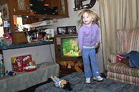 Amy Lumpkins,5, playing inside  her family's Trailer. Her family is deep in poverty living in the Appalachian mountains of Eastern Kentucky near the town of Mousie.