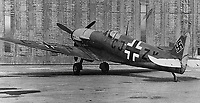 BNPS.co.uk (01202 558833)<br /> Pic: NikColeman/PBS/BNPS<br /> <br /> The unique Messer-Spit before its destruction in a USAF air raid in 1944.<br /> <br /> Remarkable photos revealing how the Germans tried to create a super plane during WW2 by combining a captured Spitfire's frame with a Daimler Benz engine have been revealed.<br /> <br /> A new documentary series called Plane Resurrection by PBS America historian Ian McLachlan reveals how the Nazi's stuck their impressive power plant from a Bf 109 fighter on the body of a captured Spitfire V b that had crash-landed on the occupied island of Jersey in November 1942.<br /> <br /> It was piloted by German born Free French pilot Lt Bernard Scheidhauer, who had joined the RAF's 101 Sqn to fight against his homeland. <br /> <br /> While the hybrid plane looked ungainly, it was actually found during testing to out perform both the German and British fighters.<br /> <br /> However it was the only one ever made, mainly because there were not enough captured Spitfires available for the Germans to mass-produce. <br /> <br /> After capture the unfortunate Scheidhauer was sent to Stalag Luft III, where he took part in the Great Escape, pairing up with its mastermind Squadron Leader Roger Bushell, after recapture they were notoriously murdered by the Gestapo.