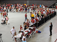 NWA Media/ANDY SHUPE - during the annual  University of Arkansas Fan Day Sunday, Aug. 17, 2014, at Bud Walton Arena in Fayetteville. The day featured opportunities to have items autographed by members of the Razorbacks volleyball, soccer, football teams, mascots and the spirit squads. Visit photos.nwaonline.com to see more photos from the event.