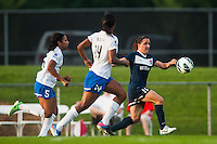 Sky Blue FC forward Lisa De Vanna (11) is marked by Boston Breakers defender Kia McNeill (14) and midfielder Lisa-Marie Woods (5) during a National Women's Soccer League (NWSL) match at Yurcak Field in Piscataway, NJ, on July 13, 2013.