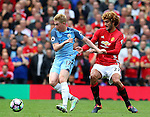 Kevin De Bruyne of Manchester City tussles with Marouane Fellaini of Manchester United during the Premier League match at Old Trafford Stadium, Manchester. Picture date: September 10th, 2016. Pic Simon Bellis/Sportimage