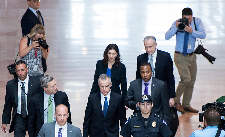 "UNITED STATES - MAY 11: Acting FBI Director Andrew McCabe, center, leaves the Hart Senate Office Building after testifying during the Senate (Select) Intelligence Committee hearing on ""World Wide Threats"" on Thursday, May 11, 2017. (Photo By Bill Clark/CQ Roll Call)"