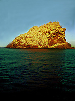 ISLE SAN PEDRO MARTIR, THE SHEER CLIFFS OF THIS MIDRIFF ISLAND HAS A RICH BIO DIVERSITY OF IT OWN LIKE MANY OF THE ISLANDS FOUND IN THE SEA OF CORTEZ OR GULF OF CALIFORNIA.