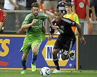 Jordan Graye #16 of D.C. United runs after Pat Noonan #25 of Seattle Sounders FC during an MLS match at RFK Stadium on July 15 2010, in Washington DC.Seattle won 1-0.
