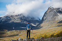 Female hiker looks down Ladtjovagge from near Kebnekaise Fjällstation, Lappland, Sweden