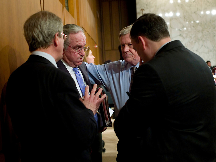WASHINGTON, DC - April 16: Senate Agriculture Chairman Tom Harkin, D-Iowa, and House Agriculture Chairman Collin C. Peterson, D-Minn., talk with aides before the House-Senate conference on the farm bill. The House passed a one-week extension of the current farm law Wednesday as conferees struggled to complete work on a new five-year farm bill. House-Senate negotiators met briefly Wednesday afternoon. After approving most forestry provisions in the bill, they broke off to allow House members to return to the floor for roll call votes on other legislation. They planned to resume their work later in the day. House Agriculture Committee Chairman Collin C. Peterson, D-Minn., said it's likely the negotiators will need another one- or two-week extension to seal a deal and finish the paperwork on the legislation (HR 2419), which carries a 10-year $560 billion budget baseline but likely will total at least $10 billion more than that. The current law expires April 18. But the Bush administration fired a warning shot at the House-Senate conferees, who have struggled for months to reach agreement on a new long-term farm bill. (Photo by Scott J. Ferrell/Congressional Quarterly)