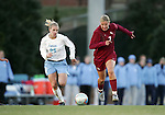 Florida State's Viola Odebrecht (7) and Carolina's Lindsay Tarpley (25) chase the ball on Friday, November 25th, 2005 at Fetzer Field in Chapel Hill, North Carolina. The Florida State Seminoles defeated the University of North Carolina Tarheels 5-4 on penalty kicks after the teams tied 1-1 after overtime during their NCAA Women's Soccer Tournament quarterfinal game.