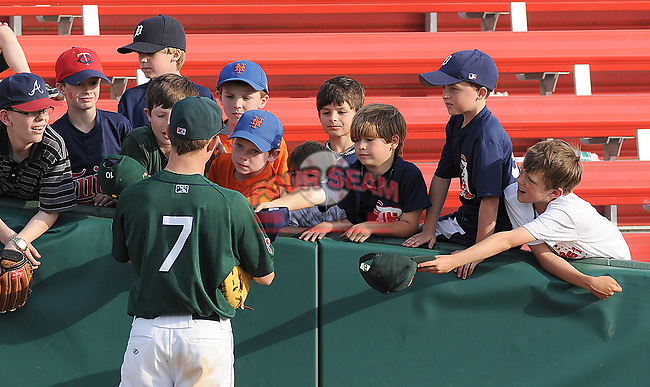 Zach Gentile (7) signs hats for some young ballplayers before a game against the Lexington Legends April 25, 2010, at Fluor Field at the West End in Greenville, S.C. Photo by: Tom Priddy/Four Seam Images