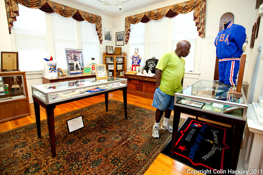 ATHLETIC ACHIEVEMENT: Studson Jefferson, Jr. of Atlanta studies the room celebrating Florida A&M athletes and coaches at The Black Archives in Tallahassee..COLIN HACKLEY PHOTO
