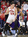 SIOUX FALLS, SD: MARCH 4: Tyler Flack #23 of South Dakota drives on Jalen Morgan #22 of Western Illinois on March 4, 2017 during the Summit League Basketball Championship at the Denny Sanford Premier Center in Sioux Falls, SD. (Photo by Dick Carlson/Inertia)