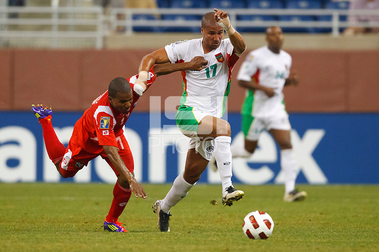 7 June 2011: Panama defender Luis Henríquez (17) and Guadeloupe midfileder Cedric Collet (17) go for the ball during the CONCACAF soccer match between Panama and Guadeloupe at Ford Field Detroit, Michigan.