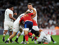 Sam Burgess of England receives a stray fist from Guilhem Guirado of France. QBE International match between England and France on August 15, 2015 at Twickenham Stadium in London, England. Photo by: Patrick Khachfe / Onside Images