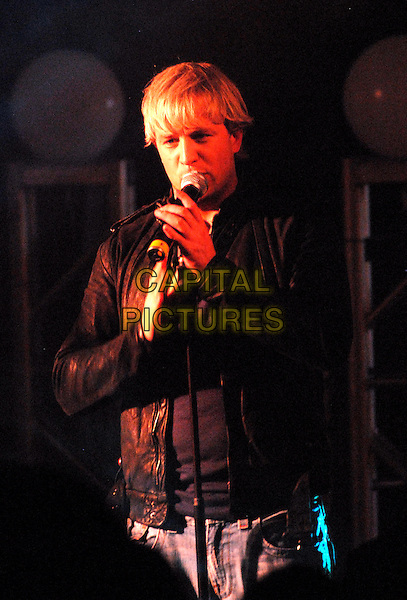 "WESTLIFE - KIAN EGAN.At Harrods to promote their 9th album ""Back Home"" with signing and performance, London, England..November 5th, 2007.half length black leather jacket stage concert live gig performance music singing .CAP/FIN.©Steve Finn/Capital Pictures."