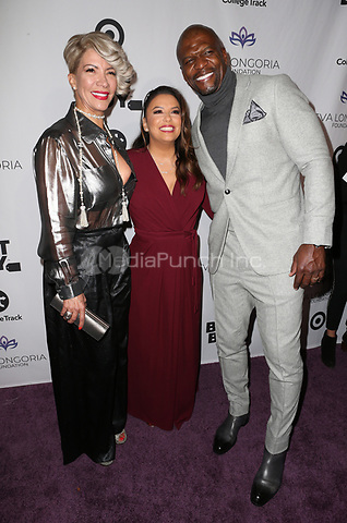 LOS ANGELES, CA - NOVEMBER 8: Rebecca King-Crews, Eva Longoria, Terry Crews, at the Eva Longoria Foundation Dinner Gala honoring Zoe Saldana and Gina Rodriguez at The Four Seasons Beverly Hills in Los Angeles, California on November 8, 2018. Credit: Faye Sadou/MediaPunch