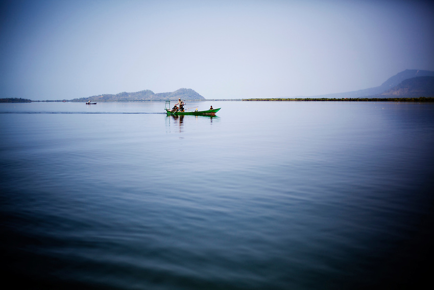 A small fishing boat is seen at the mouth of the Kampong bay estuary, Kampot province, Cambodia, February 11, 2012.