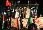 Palestinians wave with their national flag and Turkish flag during a rally in support to Turkish decision in Gaza city on Sep. 3,2011. Turkey said Friday it was expelling the Israeli ambassador and cutting military ties with Israel over the last year's deadly raid on a Gaza-bound aid flotilla. Davutoglu said Turkey was downgrading diplomatic ties to the level of second secretary and that the ambassador and other high-level diplomats would leave the capital Ankara by Wednesday. Photo by Mohammed Asad
