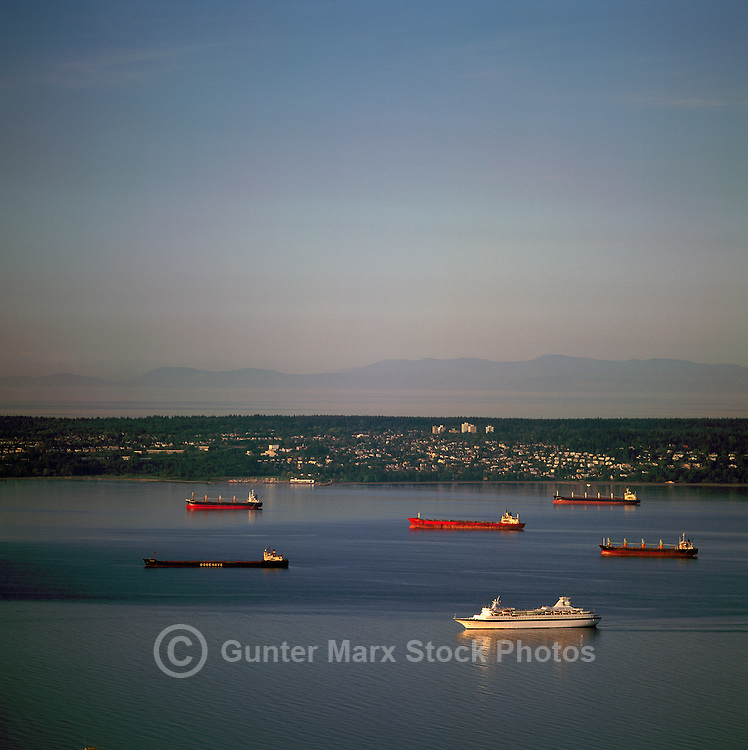 Vancouver, BC, British Columbia, Canada - Freighters at Anchor in English Bay, Cruise Ship travelling to Port of Vancouver