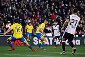 9th January 2018, Mestalla Stadium, Valencia, Spain; Copa del Rey football, round of 16, second leg, Valencia versus Las Palmas; Jonathan Calleri (center), Argentina striker for Las Palmas, watches the ball as it passes between players